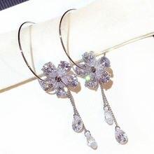 Женские серьги кольца carofeez современные с цветком и кристаллами