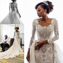 2020 Beading African Wedding Dresses Crystals Overskirts Luxury Long Sleeves Sheath Detachable Train Bridal Gowns Custom
