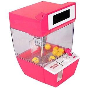 Image 2 - Lalka pazur maszyna Mini automat automat automat z cukierkami Grabber Arcade pulpit złapany zabawa muzyka śmieszne zabawki gadżety dla dzieci