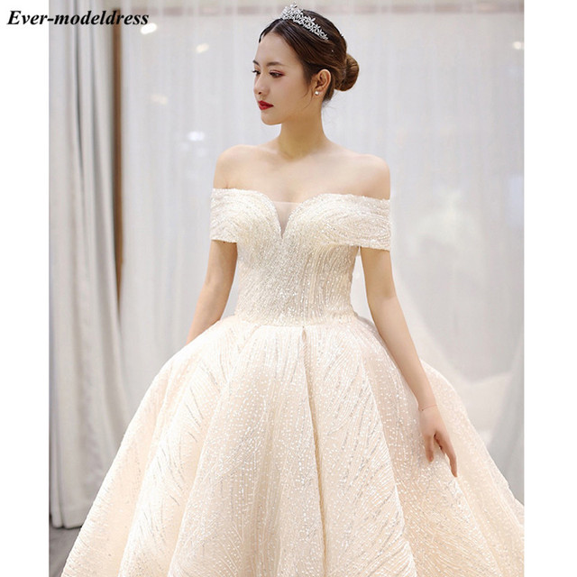 Luxury Wedding Dresses 2021 Off Shoulder African Sparkly V-Neck Lace Up Back Ball Gown Court Train Bridal Robe Do Mariee 4