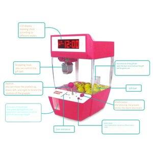 Image 4 - Lalka pazur maszyna Mini automat automat automat z cukierkami Grabber Arcade pulpit złapany zabawa muzyka śmieszne zabawki gadżety dla dzieci