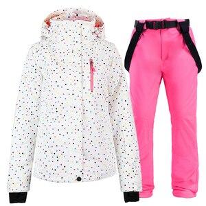 Image 1 - Ensemble de combinaison de snowboard pour femme, noir et blanc, veste + bavoir, pantalon de neige, étanche, coupe vent, hiver, respirant
