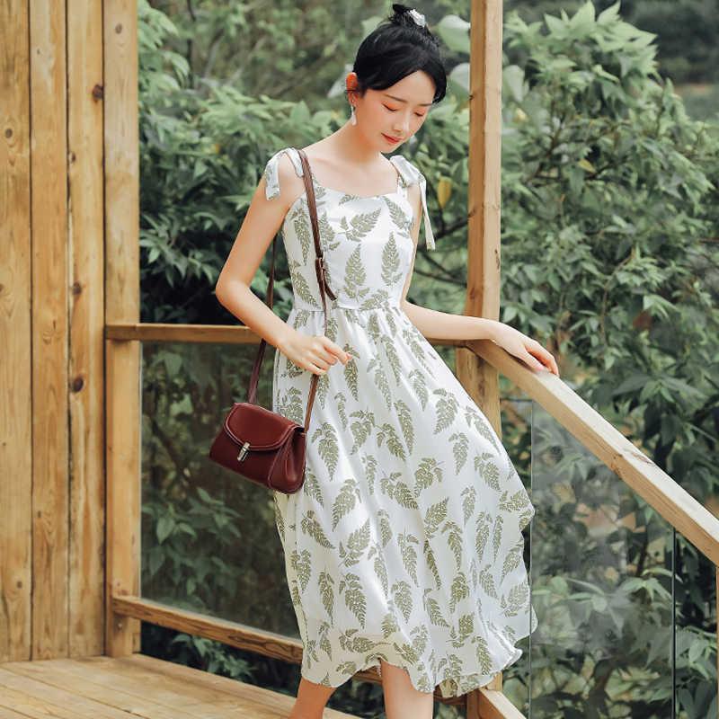 Singrain 女性の夏のボヘミアンストラップロングドレス韓国プリントシフォンシャーリングサンドレス新ホリデービーチノースリーブ花ドレス