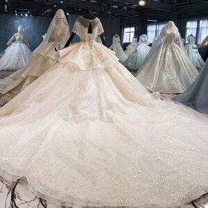 Image 2 - HTL1056 sparkly hochzeit kleid 2020 illusion oansatz perle kleine cape spitze hochzeit kleid plus größe lace up zurück vestido de casamento