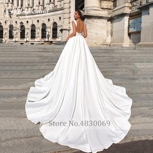 Image 2 - アシュリーキャロルサテン夜会服のウェディングドレス2020ビーズvネックノースリーブ背中高級王女の花嫁のガウンvestidoデnoiva