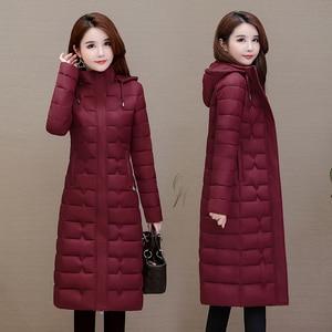 Image 2 - 冬のコートの女性生き抜く2020ロングパーカープラスサイズ4XL暖かい厚手のダウンジャケットフード付きファッションスリム固体冬服女性