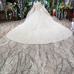 Image 2 - BGW HT4237 Ball Gown Wedding Dresses With Cape O Neck Zipper Back Applique Long Sleeves Lace Wedding Gowns 2020 Vestido De Noiva