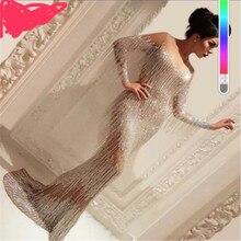 Luksusowe koraliki syrenka srebrne suknie balowe 2020 Sexy suknie wieczorowe z długim rękawem z pomponem Robe de soiree