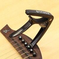 1 pc Capo per chitarra in lega di zinco nero per chitarre elettriche acustiche Ukulele mandolino Banjo con 2 plettri