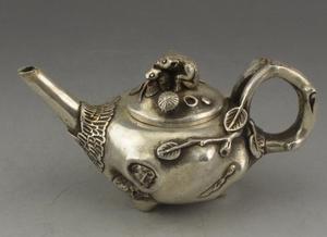 Tetera de pata de rana loto tallada a mano pura de plata tibetana de China