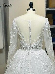 Image 5 - فستان عروس من Liyuke بأكمام طويلة لحفلات الزفاف مع دانتيل رائع من قطار مصلى