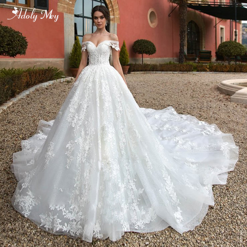 Adoly Mey New Romantic Boat Neck Lace Up Ball Gown Wedding Dresses 2020 Luxury Beaded Appliques Chapel Train Princess Bride Gown