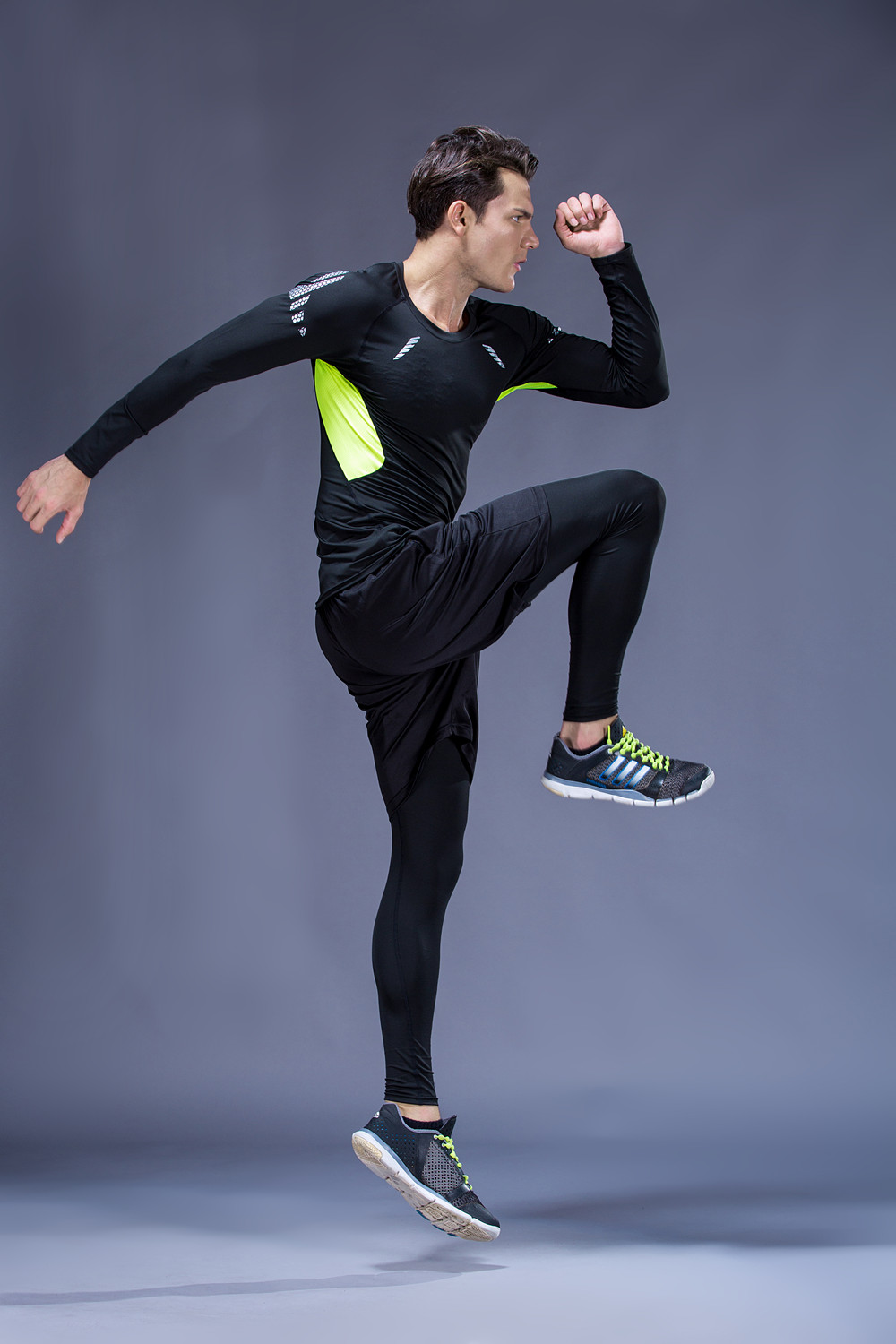 Foto from the left 5 pcs compressions clothes for gym. Men's 5 pcs compression tracksuit sports