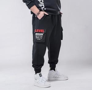 Image 1 - בתוספת גודל 7xl 6xl 5xl מכנסיים מטען גברים מוצק צבע שחור Loose מקרית Jogger כיס אלסטי מותניים קרסול אורך מכנסיים