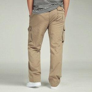 Image 4 - 夏男性のハイウエストパンツ弾性プラスサイズの服 6XLカーゴパンツ男性多くポケットルーズワークパンツ男性ストレートズボン