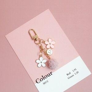 Cute Romantic Flower Sakura Fur Ball Gold Metal Letter Trinket Key Chains Car Bag Pendent Charm AirPods Accessories D377(China)