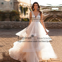 2019 New Cheap A Line Wedding Dresses V neck Robe de mariage Sexy Lace Bridal Dress Sleeveless Backless Ruffles Wedding Gown