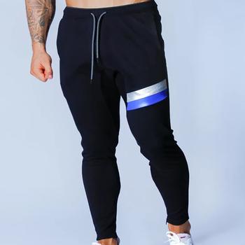 Męskie spodnie dresowe Jogger Fitness męskie odzież sportowa odzież sportowa spodnie obcisłe spodnie dresowe czarne spodnie dresowe Gym tanie i dobre opinie Na co dzień Pełnej długości COTTON skinny Men s jogging pants Midweight