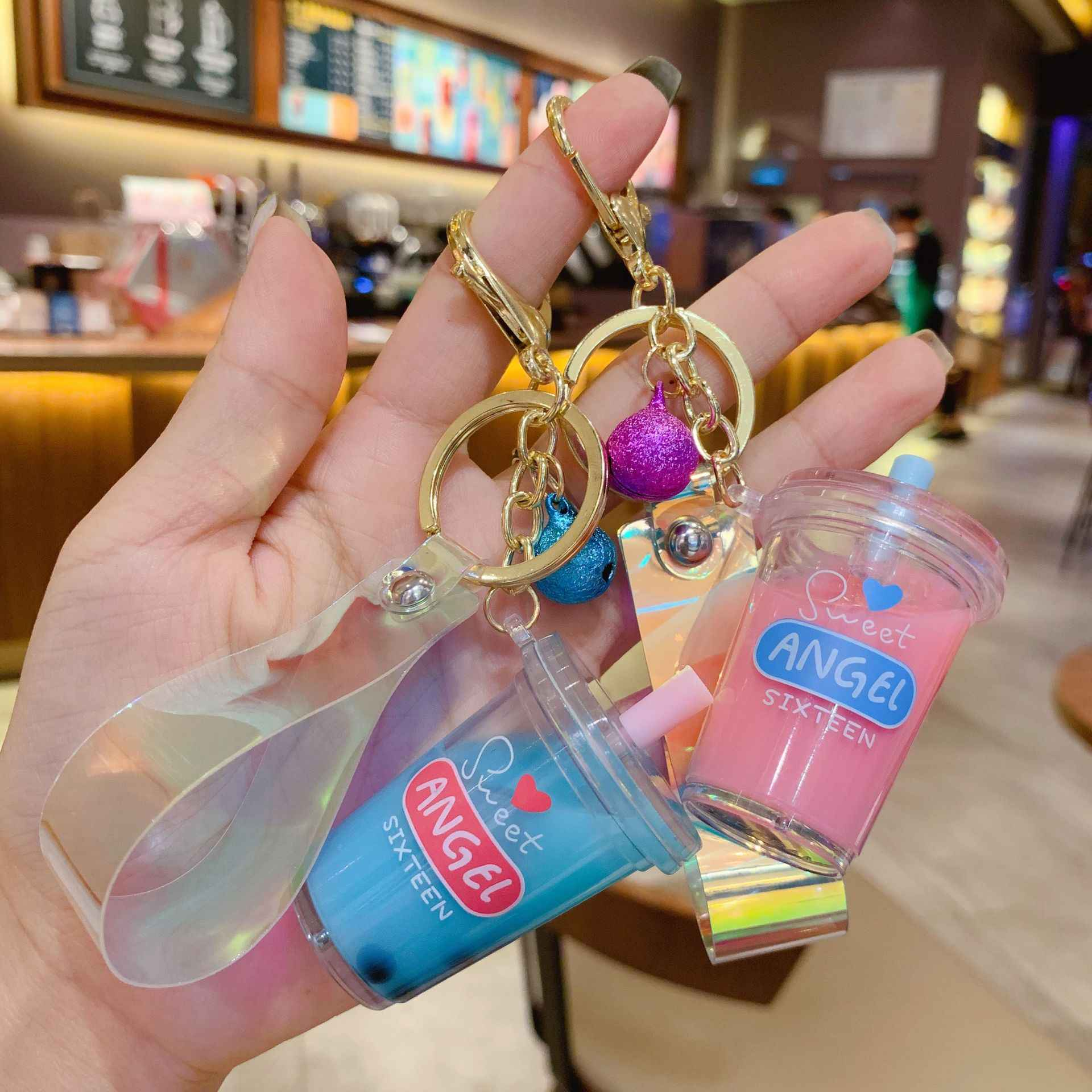 New Moving Liquid keychain Creative cartoon acrylic milk tea cup quicksand keychains car metal key chain bag pendant key ring