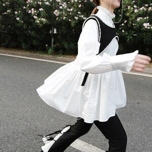 Image 2 - [EAM]2020 New Spring Autumn Stand Collar Long Sleeve White Loose Ruffles Stitch  Irregular Shirt Women Blouse Fashion Tide JL679