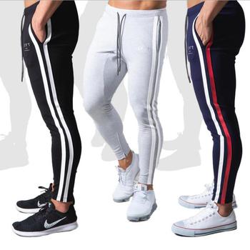 Męskie spodnie Fitness dorywczo elastyczne spodnie mężczyźni odzież sportowa do kulturystyki Casual granatowy wojskowe spodnie dresowe spodnie joggery 20CK21 tanie i dobre opinie ENJPOWER rurki CHINA W STYLU ANGIELSKIM Elastyczny pas Mieszkanie Pełna długość POLIESTER COTTON REGULAR 2 2 - 3 6 średniej wielkości