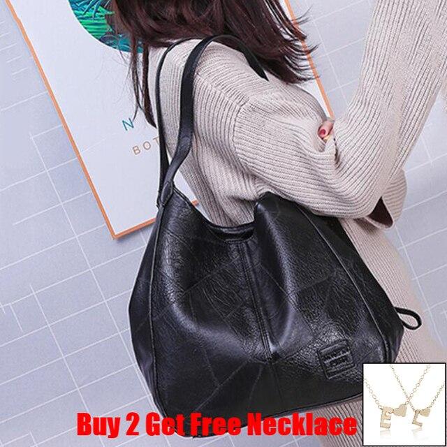 Женская кожаная сумка с ручками и тремя отделениями 2