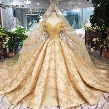 HTL313黄金のウェディングドレス2020でベールvネッククリスタルタッセル王女ブライダルドレスアップリケボールガウン
