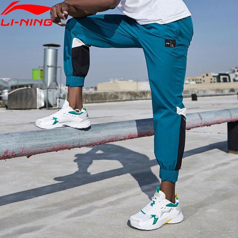 Li-Ning Men Training Track Pants 88% Nylon 12% Spandex Regular Fit LiNing Li Ning Hit-Color Sports Pants Trousers AYKQ053 MKY551