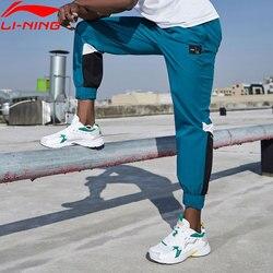 Li-ning serie de entrenamiento de los hombres pantalones de pista 88% Nylon 12% Spandex Regular Fit forro Hit-Color Pantalones deportivos AYKQ053 MKY551