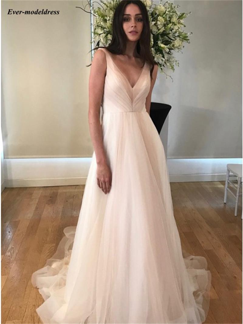 Gracieuse Tulle v-cou robes de mariée 2019 sans manches dos nu été jardin robes de Mariage avec poches balayage Train Vestidos