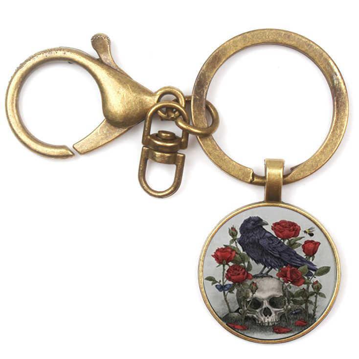 Glamour Dark Black Raven and Taro Crystal Pendant Man Woman Keychain Fashion Quality Car Charm Pack Convex Glass Key Chain Gift
