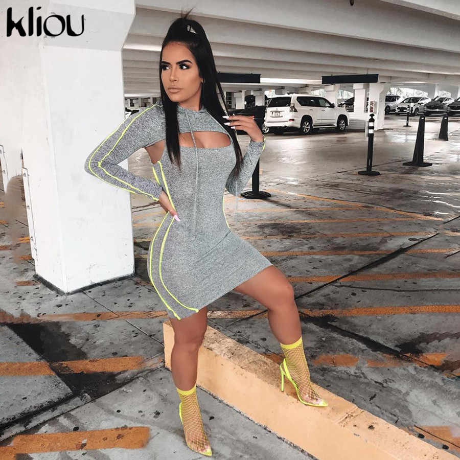 Kliou 2 点セットドレス中空アウトアジショートフード付き巾着女性ドレス秋のストリートパーカートレーナードレス