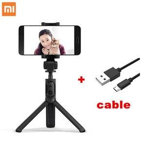 Image 1 - Xiaomi portable Mini trépied pliable 2 en 1 monopode Selfie bâton Bluetooth sans fil télécommande obturateur pour téléphones Iphone
