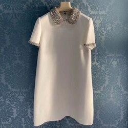 Marque de mode femmes haut de gamme de luxe été élégant mince perlé diamant couleur unie robe à manches courtes en vrac