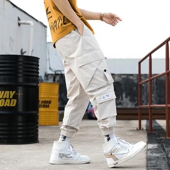 2020 New Hot Joggers Hip Hop Cargo Pants Men Harem Pants Multi-Pocket Ribbons Man Sweatpants Streetwear Men Pants men hip hop joggers cargo pants black pocket patchwork ribbons men jogger harem pants fashions trousers hip hop streetwear