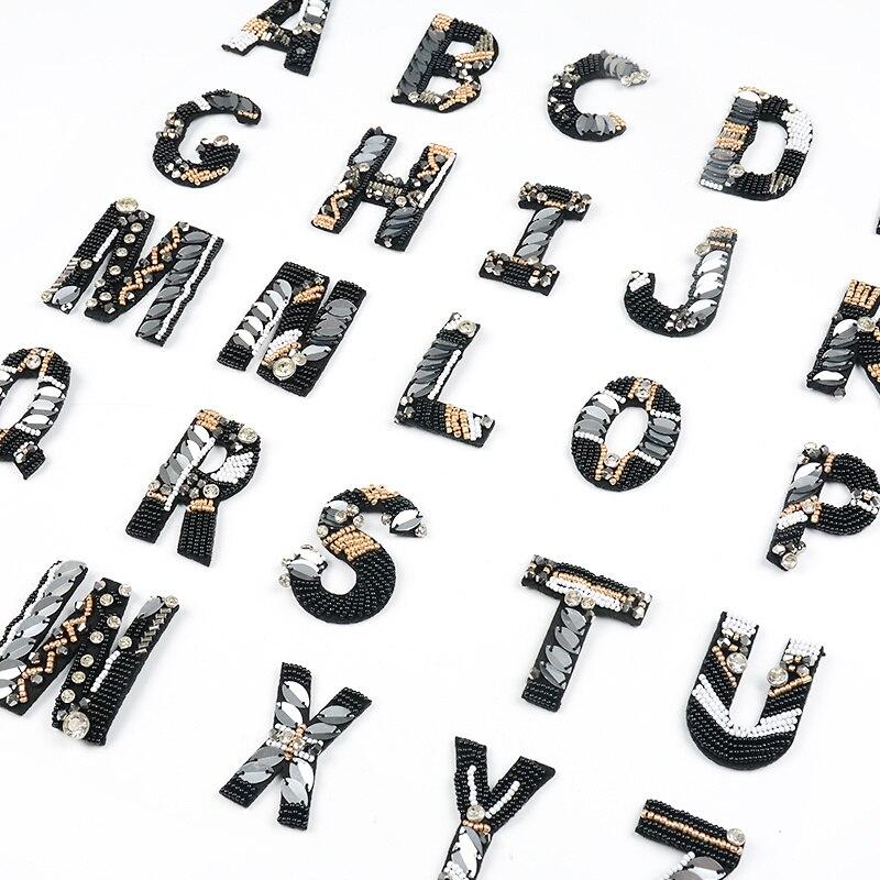 TANGGER Parches Termoadhesivos,26Pcs de Letra del Alfabeto Lentejuelas A-Z Bordados DIY de Costura de Decoraci/ón Applique Parches para la camiseta Jeans Ropa Bolsas