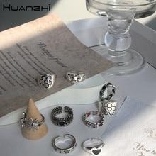 HUANZHI 2020 nowy koreański Vintage Daisy Flower czarne serce Glaze smutna mina kolor srebrny metalowe pierścionki dla kobiet para pierścień biżuteria