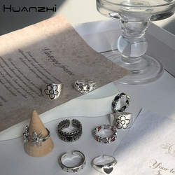HUANZHI 2020 New Korean Vintage Daisy Flower Black Heart Glaze Sad Face Silver Color Metal Rings for Women Couple Ring Jewelry