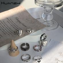 HUANZHI 2020 nowy koreański Vintage Daisy Flower czarne serce Glaze smutna mina kolor srebrny metalowe pierścionki dla kobiet para pierścień biżuteria tanie tanio CN (pochodzenie) Ze stopu aluminium Kobiety Archiwalne Pierścień pokazowy GEOMETRIC Zgodna ze wszystkimi Poprawiające nastrój