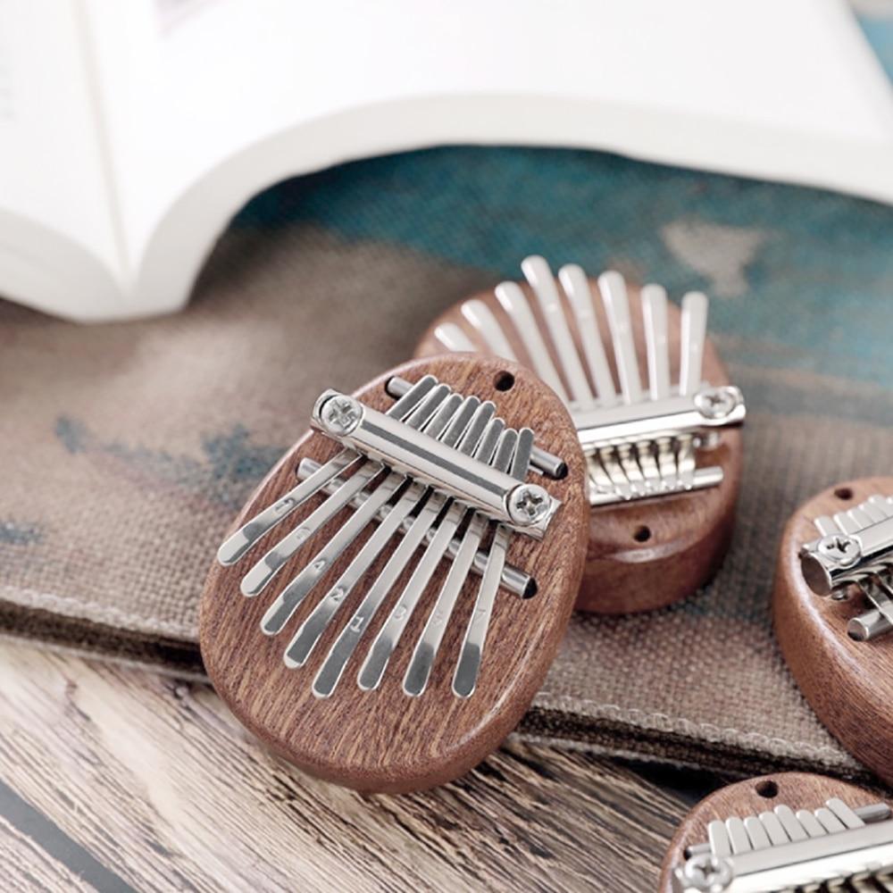 8 schlüssel Mini Kalimba Exquisite Finger Daumen Klavier Marimba Tragbare Musical Gute Zubehör Anhänger Geschenk für Anfänger