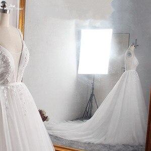 Image 5 - LZ400 Shiny Parels Kleine Bloemen Trouwjurk V hals Mouwloos A lijn Bridal Jurk Met Sluier Vestido De Noiva
