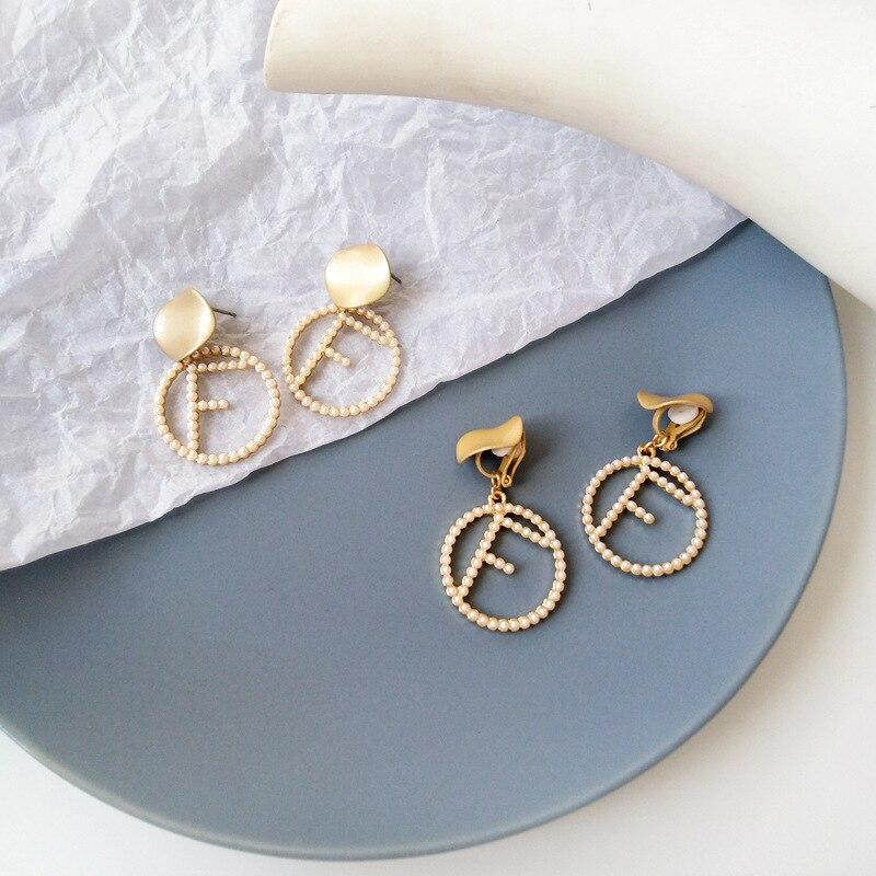 Japan Korea statement earrings temperament lady swing letter pearl drop earrings for women in Drop Earrings from Jewelry Accessories