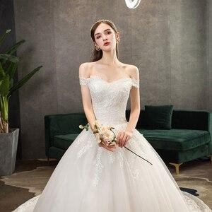 Image 5 - Neue Ankunft Süße Elegante Prinzessin Luxus Spitze Hochzeit Kleid 100 cm Boot ausschnitt Appliques Promi Ballkleid vestido De Noiva