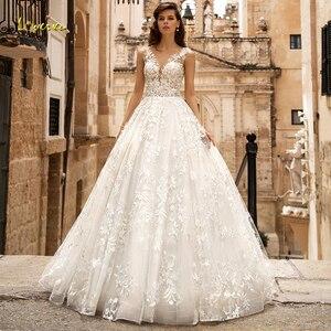 Image 1 - Loverxu V Neck A Line Lace Wedding Dresses Delicate Appliques Cap Sleeve Button Bride Dresses Court Train Bridal Gowns Plus Size