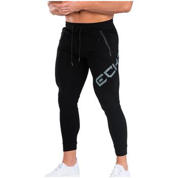 Spodnie dresowe dla joggerów męskie spodnie dorywczo siłownia spodnie treningowe męskie wiosna jesień bawełna Skinny Running spodnie do biegania odzież sportowa tanie i dobre opinie GLOBESKY Na co dzień Sznurek Mieszkanie Pełnej długości Poliester COTTON 28 - 35 List Men s Running Track Pants Midweight