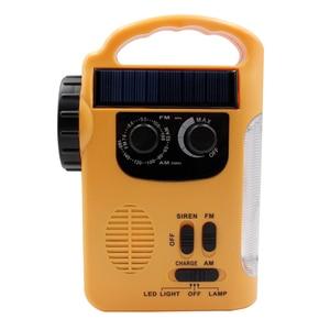 Image 3 - Portable Solar Powered AM/FM Radio with LED Flashlight Electronics Dynamo Automotive Hand Crank Emergency Camping Power Bank