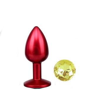 Red metal anal plug yellow diamond