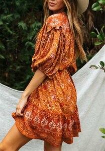 Image 2 - בציר שיק נשים כתום פרחוני הדפסת שרוול פנס ציצית חוף בוהמי מיני שמלות גבירותיי V צוואר זהורית Boho שמלה