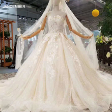 LSS214 Sexy bez ramiączek suknia ślubna 2020 z pomponem welon slubny Backless suknie balowe aplikacje cekinami