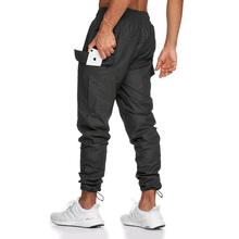 Siłownia sportowe spodnie męskie siłownia trening multi-pocket spodnie do fitnessu moda męska wodoodporne czarne spodnie do joggingu spodnie tanie tanio GYMCUCGV Ołówek spodnie Sznurek Mieszkanie Pełnej długości NYLON REGULAR Kieszenie Midweight Twill